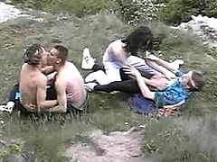 Gay hippies having copulation in nature