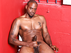 Hot and horny brown stud wanks his mammoth brown weenie off