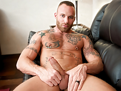 After a want day, Derek relaxes on a couch with cock in hand