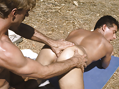 Alex down on his knees blowing the hiker's large love muscle