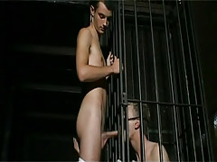 Bad gay guy in cage sucks hard cock