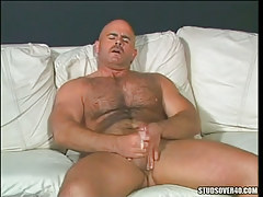 Horny bear twink cums after cock stroking