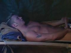 Cute twink masturbates in bed