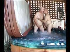 Fat grown twinks giving a kiss in pool