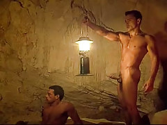 Sexy gay hunks have joy in cave
