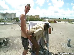 Black and white faggots fuck in doggy style on roof