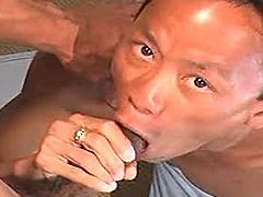 Asian twinks have a steamy oral session on the couch